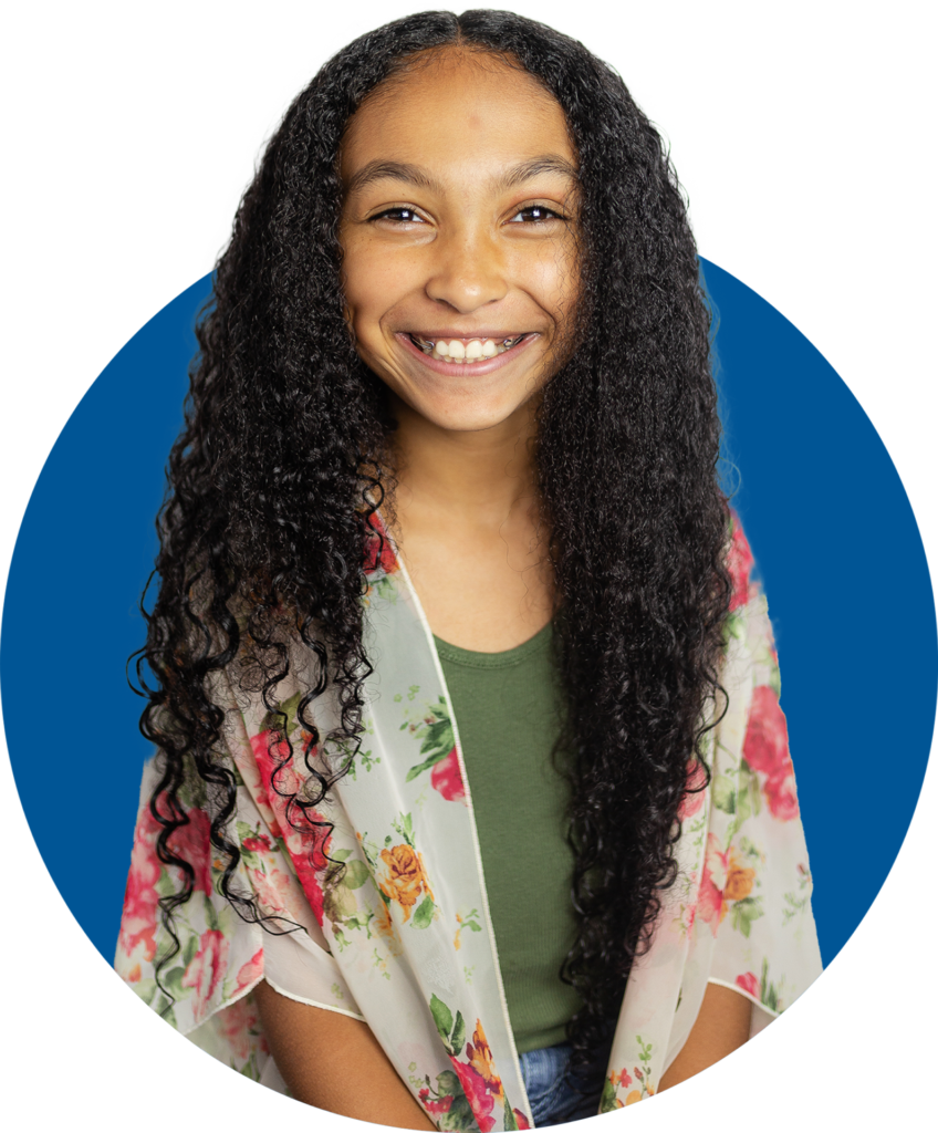 African American girl with beautiful long hair smiling